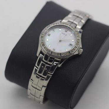Woman's Guess watch with beautiful pearl face and surrounding crystals.