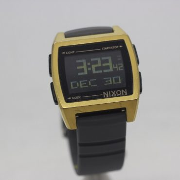 gold faced Nixon Home Based watch with grey rubber band.